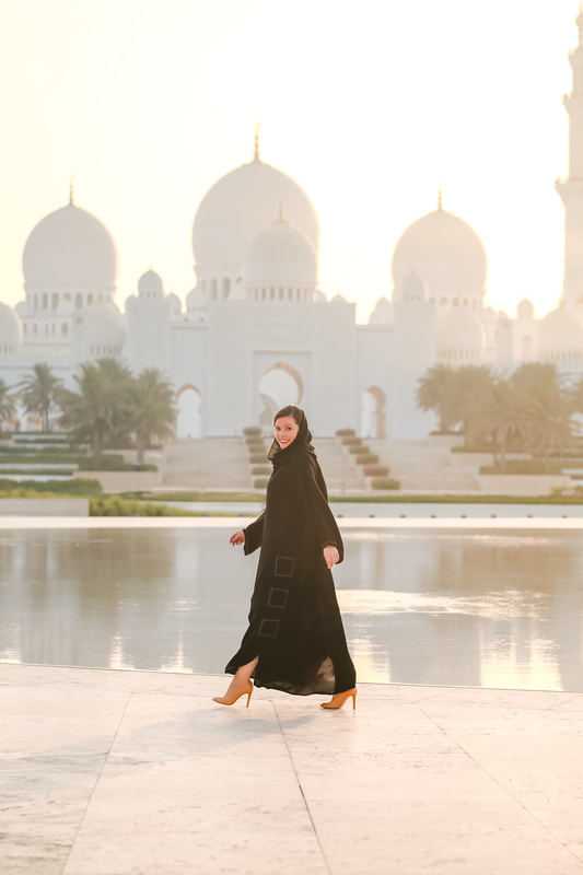 In a traditional Abaya in front of Sheikh Zayed Grand Mosque